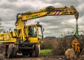 Excavator on land with potential restrictive covenants