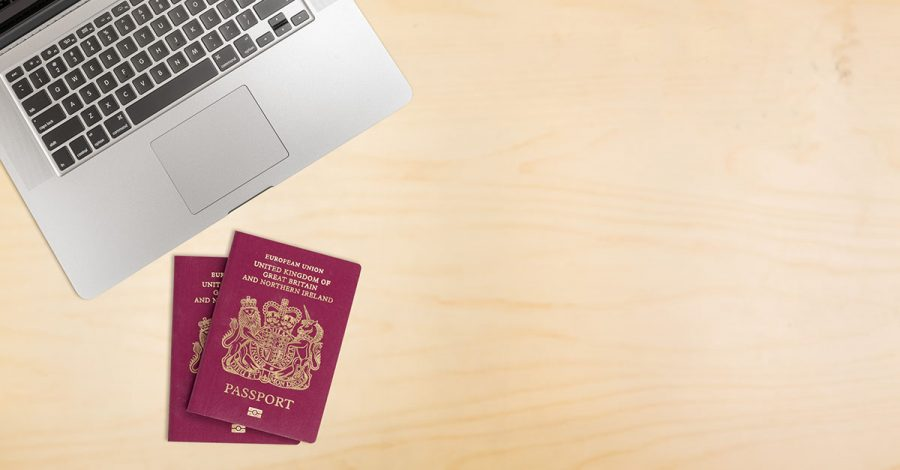 Desk with laptop and UK passports for Right to work